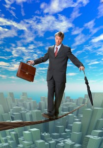 Businessman balancing on rope over a big city - control your life