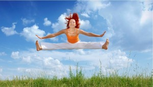 Confidence in being yourself - girl doing the splits midair